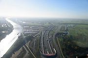 Nederland, Utrecht, Utrecht, 24-10-2013;<br /> Rijksweg A2 en de zuidelijke ingang van de  Leidsche Rijntunnel, een landtunnel die de verkeersoverlast, luchtvervuiling en geluidsoverlast voor Utrecht en de Vinexwijk Leidsche Rijn moet verminderen. Links het Amsterdam-Rijnkanaal. Stadsbaan rechts van de tunnel.<br /> Roadway A2 and the southern entrance to the tunnel Leidsche Rijn, a landtunnel built to decrease the nuisance of traffic noise and air pollution for the city of Utrecht and the suburb Leidsche Rijn. Left the Amsterdam-Rhine Canal.<br /> luchtfoto (toeslag op standaard tarieven);<br /> aerial photo (additional fee required);<br /> copyright foto/photo Siebe Swart.