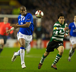 LIVERPOOL, ENGLAND - Tuesday, February 16, 2010: Everton's Sylvain Distin and Sporting Clube de Portugal's Matias Fernandez during the UEFA Europa League Round of 32 1st Leg match at Goodison Park. (Photo by: David Rawcliffe/Propaganda)