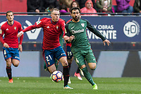 Carlos Clerc of Club Atletico Osasuna competes for the ball with Makel Susaeta of Athletic Club during the match of  La Liga between Club Atletico Osasuna and Athletic Club Bilbao at El Sadar Stadium  in Pamplona, Spain. April 01, 2017. (ALTERPHOTOS / Rodrigo Jimenez)
