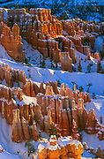 Winter sunset at Bryce Canyon National Park, Sunrise Point. Bryce Canyon National Park, a sprawling reserve in southern Utah, is known for crimson-colored hoodoos, which are spire-shaped rock formations. The park's main road leads past the expansive Bryce Amphitheater, a hoodoo-filled depression lying below the Rim Trail hiking path. It has overlooks at Sunrise Point, Sunset Point, Inspiration Point and Bryce Point. Prime viewing times are around sunup and sundown.