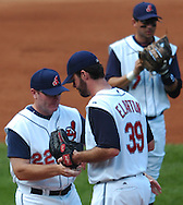 MORNING JOURNAL/DAVID RICHARD<br />Cleveland manager Eric Wedge, left, takes the ball from starter Scott Elarton with no outs and two runners on base in the third inning yesterday against the White Sox.