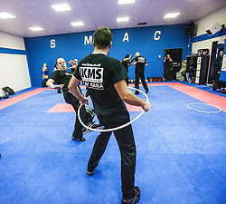 Kicking under the area of the hoop, Stef Noij, KMG Instructor from the Institute Krav Maga Netherlands, at the IKMS G Level Programme seminar today at the Scottish Martial Arts Centre, Alloa.