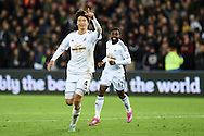 Ki Sung-Yueng of Swansea city (l)  celebrates after he scores his teams 1st goal. Barclays Premier league match, Swansea city v Queens Park Rangers at the Liberty stadium in Swansea, South Wales on Tuesday 2nd December 2014<br /> pic by Andrew Orchard, Andrew Orchard sports photography.