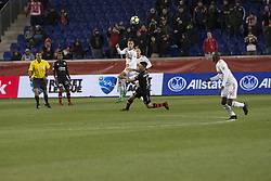 March 13, 2018 - Harrison, New Jersey, United States - Florian Valot (22) of Red Bulls & Damian Musto (5) of Club Tijuana fight for ball during Scotiabank Concacaf Champions League quarterfinal second leg game at Red Bull Arena Red Bulls won 3 - 1  (Credit Image: © Lev Radin/Pacific Press via ZUMA Wire)
