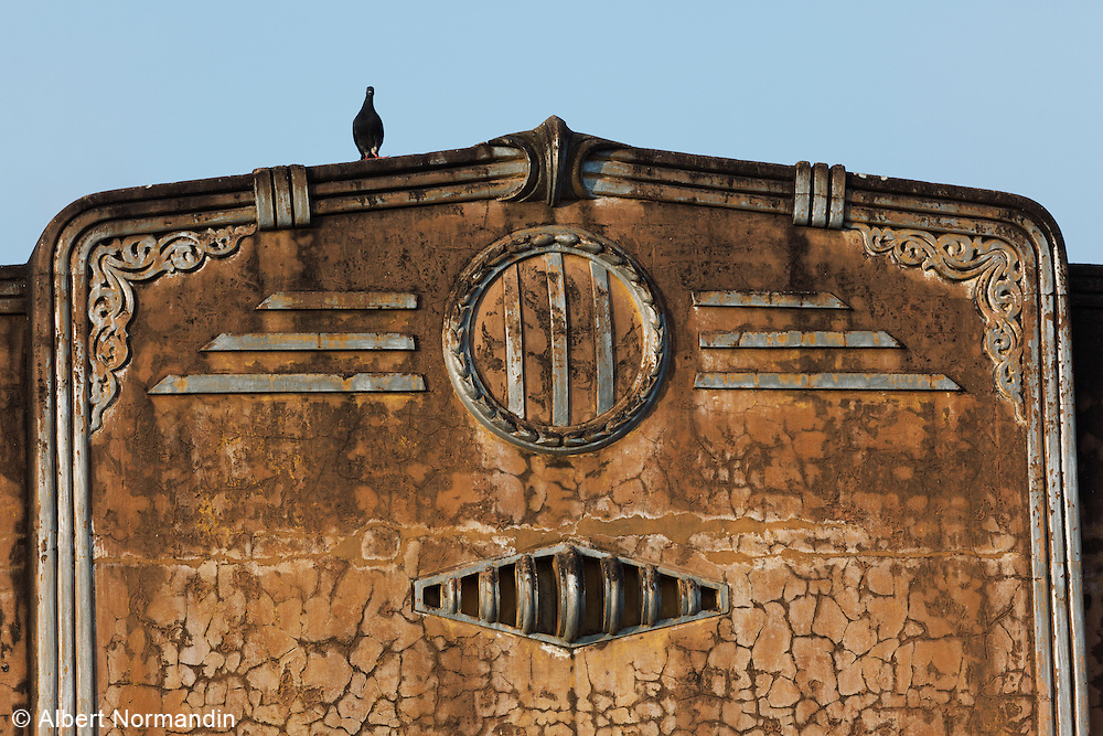 Old colonial building facade with bird on top, Pyin Oo Lwin