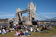 People enjoying some sunny weather socialising at Potters Fields Park, More London and overlooking the Tower Bridge on 17th April 2021 in London, United Kingdom.