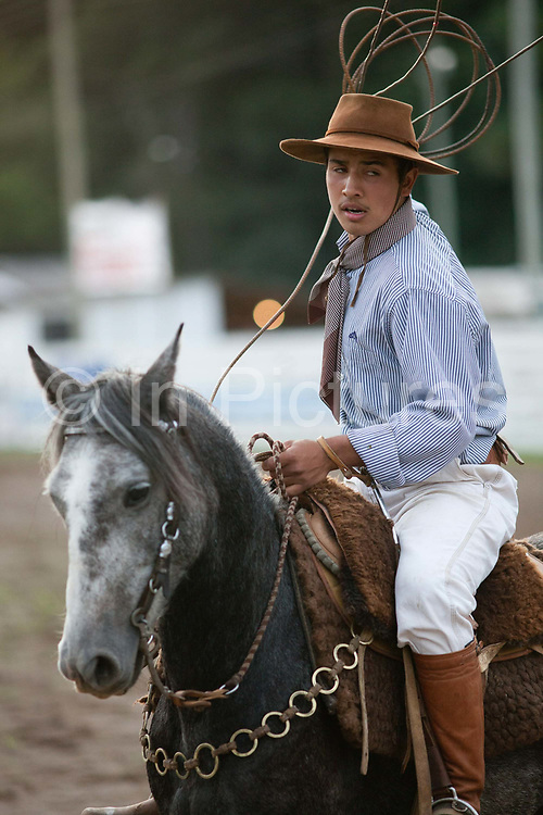 Brazilian Gaucho cowboy male, on his horse preparing to ride out in to the ring, competing in a Rodeo. Gaucho cowboy Rodeo, Flores de Cunha, Rio Grande do Sul.