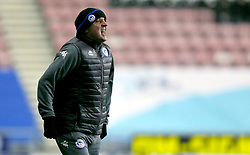 Wigan Athletic manager Paul Cook gestures on the touchline