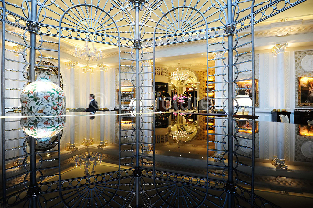 """The Thames foyer is seen reflected from a grand piano of the Savoy Hotel in London. The iconic hotel reopened after a three year refit that cost £220 million ($350 million). The Savoy Hotel is a located on the Strand, in central London. Built by impresario Richard D'Oyly Carte the hotel opened on 6 August 1889. It was the first in the Savoy group of hotels and restaurants owned by Carte's family for over a century. It has been called """"London's most famous hotel"""" and remains one of London's most prestigious and opulent hotels, with 268 rooms and panoramic views of London."""