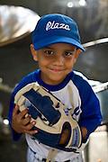 Caracas_VEN, Venezuela..Garoto usando uniforme de baseball em Caracas, Venezuela...Boy wearing a baseball uniform in Caracas, Venezuela...Foto: JOAO MARCOS ROSA / NITRO