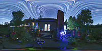 Backyard Late Summer Nighttime Sky Over New Jersey. Equirectangular 360 degree Panorama. Composite of 360 (DNG) images taken with a Ricoh Theta Z1 360 camera (ISO 400, 2.6 mm, f/2.1, 60 sec). DNG images processed with Capture One Pro, converted to 360 Equirectangular with PTGUI, Star Trail composite generated with PhotoShop CC (scripts, statistics, maximum).