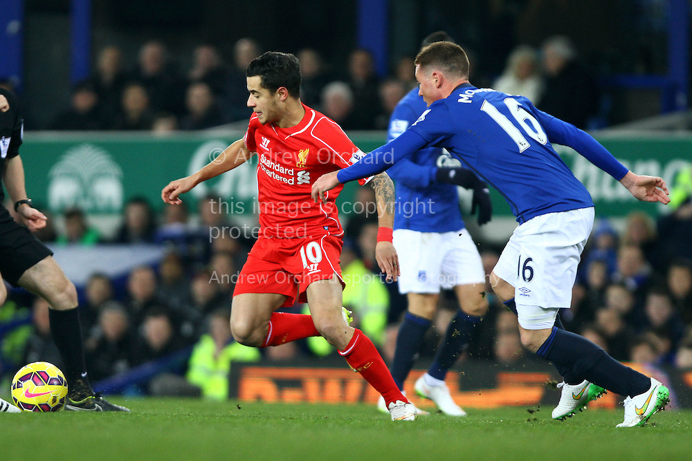 Philippe Coutinho of Liverpool gets away from James McCarthy of Everton. Barclays Premier league match, Everton v Liverpool at Goodison Park in Liverpool, Merseyside on Saturday 7th February 2015<br /> pic by Chris Stading, Andrew Orchard sports photography.