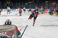 KELOWNA, CANADA - DECEMBER 7:  Dallon Wilton #15 of the Kelowna Rockets warms up with a shot on net against the Victoria Royals on December 7, 2018 at Prospera Place in Kelowna, British Columbia, Canada.  (Photo by Marissa Baecker/Shoot the Breeze)