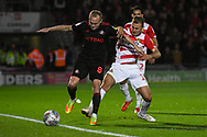 Herbie Kane of Doncaster Rovers (15) tackles Dylan McGeouch of Sunderland (8) during the EFL Sky Bet League 1 match between Doncaster Rovers and Sunderland at the Keepmoat Stadium, Doncaster, England on 23 October 2018.