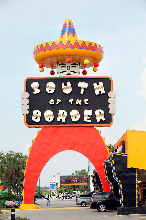 """South of the Border is an internationally-know roadside attraction on Interstate 95 near Dillon, South Carolina, so named because it is just """"south of the border"""" between the U.S. states of South and North Carolina. Intentionally campy and over-the-top, the rest area features restaurants, gas stations, motels, a small amusement park, shopping and fireworks. Its mascot is Pedro, an extremely unpolitically-correct Mexican bandido. It is advertised by hundreds of billboards along surrounding highways that start 175 miles away. Photo by LOGAN MOCK-BUNTING"""