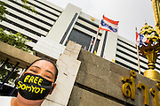 """23 JANUARY 2013 - BANGKOK, THAILAND: A supporter of Somyot Prueksakasemsuk wears a gag to show his support for the convicted magazine editor. Somyot was sentenced to 11 years imprisonment for """"Lese Majeste"""" violations Wednesday. He was arrested on April 30, 2011, and charged under article 112 of Thailand's penal code, which states that """"whoever defames, insults or threatens the King, the Queen, the Heir-apparent or the Regent, shall be punished with imprisonment of three to fifteen years"""" after the magazine he edited, """"Red Power"""" (later changed to """"The Voice of Thaksin"""") published two articles by Jit Pollachan, the pseudonym of Jakrapob Penkair, the exiled former spokesman of exiled fugitive former Prime Minister Thaksin Shinawatra. Jakrapob, now living in Cambodia, has never been charged with any crime for what he wrote.       PHOTO BY JACK KURTZ"""