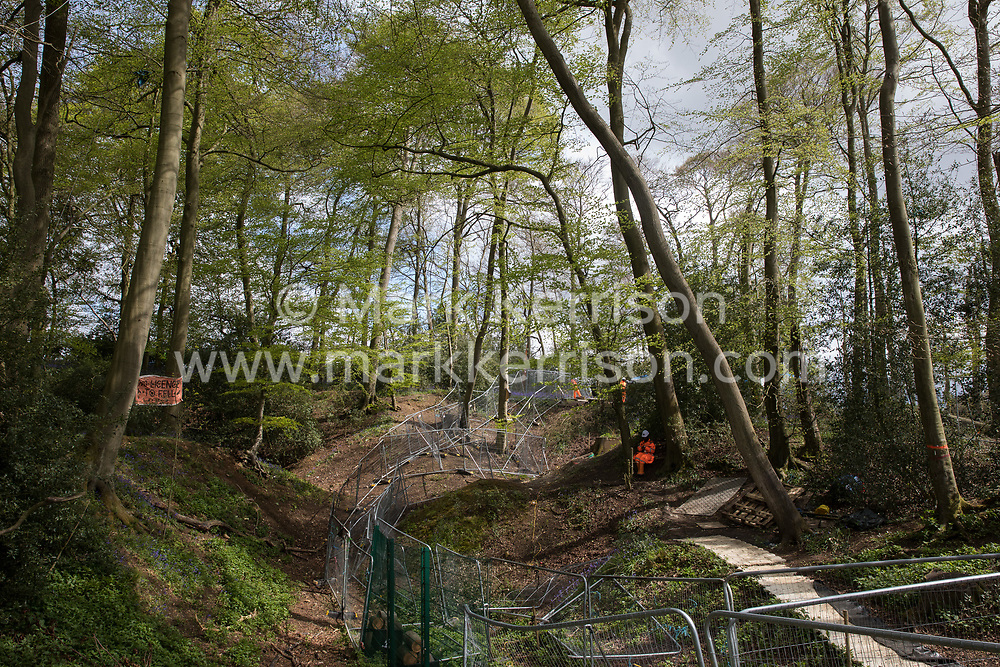 Wendover, UK. 9th May, 2021. A section of ancient woodland at Jones Hill Wood which is being felled for the HS2 high-speed rail link is viewed across fencing from a section which will remain. Felling of Jones Hill Wood, which contains resting places and/or breeding sites for pipistrelle, barbastelle, noctule, brown long-eared and natterer's bats and is said to have inspired Roald Dahl's Fantastic Mr Fox, resumed after a High Court judge lifted an injunction preventing further felling and refused an application for judicial review.