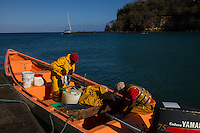 Anse La Raye, Saint Lucia: Fishermen return in the early morning after a night a sea.