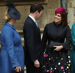 Members of the Royal family, Zara Tindall (left) Princess Eugenie and her fiance Jack Brooksbank, wait for Queen Elizabeth II to arrive for the Easter Mattins Service at St George's Chapel, Windsor Castle, Windsor.