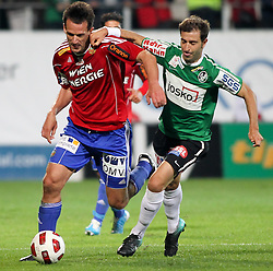 22.09.2010, Keine Sorgen Arena, Ried im Innkreis, AUT, 1.FBL, SV Josko Fenster Ried vs SK Rapid Wien, im Bild Nacho, (SV Josko Ried, Sturm, #11) und Jan Vennegoor of Hesselink, (SK Rapid Wien, #10), EXPA Pictures © 2010, PhotoCredit: EXPA/ R. Hackl / SPORTIDA PHOTO AGENCY