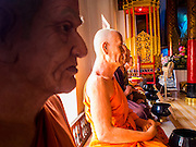 """03 APRIL 2015 - CHIANG MAI, CHIANG MAI, THAILAND: Lifelike statues of deceased revered monks in the """"wiharn"""" (prayer hall) at Wat Phakhao, a temple in Chiang Mai, Thailand. The temple was built between 1487 and 1491 and was the home temple for  Thaomekuthisuthiwong, the 15th King of the Mangrai Dynasty, which ruled Chiang Mai before it became a part of Siam (Thailand).      PHOTO BY JACK KURTZ"""