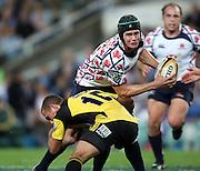 Berrick Barnes runs at Aaron Cruden. NSW Waratahs v Hurricanes. 2010 Super 14 Rugby Union round 14 match played at the Sydney Football Stadium, Moore Park Australia. Friday 14 May 2010. Photo: Clay Cross/PHOTOSPORT