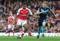 Football - 2016 / 2017 Premier League - Arsenal vs. Middlesbrough<br /> <br /> Alex Iwobi of Arsenal and Adam Clayton of Middlesbrough at The Emirates.<br /> <br /> COLORSPORT/ANDREW COWIE