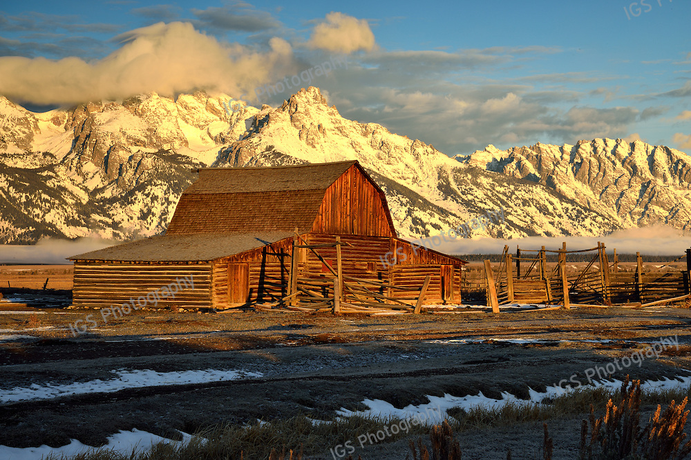 Winter view of the Historic John Moulton Barn At Sunrise in Grand Teton National Park