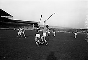 05/02/1967<br /> 02/05/1967<br /> 5 February 1967<br /> National Hurling League: Cork v Dublin at Croke Park, Dublin. <br /> Cork forward, C. McCarthy (13), and P. Maycock (right) go for a high ball with Cork forward, J. Russell (second left) and Dublin's E. Malone watching the outcome.