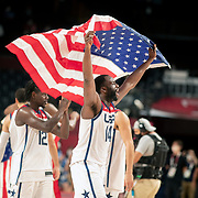 TOKYO, JAPAN August 7:  Draymond Green #14 of the United States with a Unites States flag as the team celebrate their gold medal win during the France V USA basketball final for men at the Saitama Super Arena during the Tokyo 2020 Summer Olympic Games on August 7, 2021 in Tokyo, Japan. (Photo by Tim Clayton/Corbis via Getty Images)