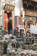 Market stall in street with lots of ornate antiques for sale, Old Street, Tunxi district, Huangshan City, Anhui Province, China