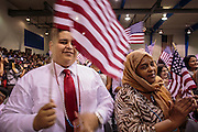 04 JULY 2012 - PHOENIX, AZ:   ISRAEL NEVAREZ (left), originally from Mexico, and MAI ALI, originally from Somalia, cheer after becoming US citizens Wednesday. About 250 people, from 62 countries, were naturalized as US citizens during the 24th Annual Fiesta of Independence naturization ceremony at South Mountain Community College in Phoenix Wednesday. The ceremony was presided over by the Honorable Roslyn O. Silver, Chief United States District Court Judge.  PHOTO BY JACK KURTZ