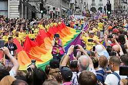 © Licensed to London News Pictures. 06/07/2019. London, UK. Over 30,000 participants take part in the annual Pride Parade in central London. An estimated over 1 million people lined along the route in support of the LGBT (Lesbian, Gay, Bisexual and Transgender/Transsexual) community. Photo credit: Dinendra Haria/LNP