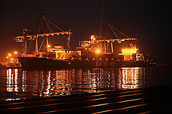 """The MSC Ingrid is unloaded all through the night at the port of Limassol in Cyprus on Feb. 22, 2008. Cyprus is the crossroads of international ship management and  where all the agencies are recruiting and hiring the cheapest workers worldwide. Cyprus is also one of the """"Flag-of-Convenience"""" States like Panama and Liberia."""