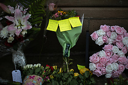 © Licensed to London News Pictures . 22/05/2019. Manchester, UK . Flowers and tributes left outside St Ann's Church . People in St Ann's Square in Manchester City Centre on the second anniversary of the Manchester Arena bombing following a private service in St Ann's Church . On the evening of 22nd May 2017 , Salman Abedi murdered 22 people and seriously injured dozens more , when he exploded a bomb in the foyer of the Manchester Arena as concert-goers were leaving an Ariana Grande gig . Photo credit: Joel Goodman/LNP