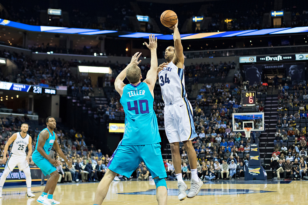 MEMPHIS, TN - OCTOBER 30:  Brandan Wright #34 of the Memphis Grizzlies shoots a hook shot over Cody Zeller #40 of the Charlotte Hornets at the FedEx Forum on October 30, 2017 in Memphis, Tennessee.  NOTE TO USER: User expressly acknowledges and agrees that, by downloading and or using this photograph, User is consenting to the terms and conditions of the Getty Images License Agreement.  The Hornets defeated the Grizzlies 104-99.  (Photo by Wesley Hitt/Getty Images) *** Local Caption *** Brandan Wright; Cody Zeller
