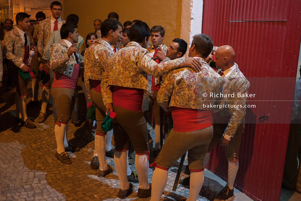 """A group of Portugese Forcados stand outside the bullring and show their camaraderie before the evening's bullfight (Corrida de Touros), on 15th July 2016, at Caldas da Rainha, Portugal. A forcado is a member of a group of men that performs the pega de cara or pega de caras (""""face catch""""), the final event in a typical Portuguese bullfight. They were initially professionals from lower classes but nowadays people from all social backgrounds practice their art through amateur groups. Unlike Spanish bullfights, in the Portuguese version, they do not kill the bull. (Photo by Richard Baker / In Pictures via Getty Images)"""