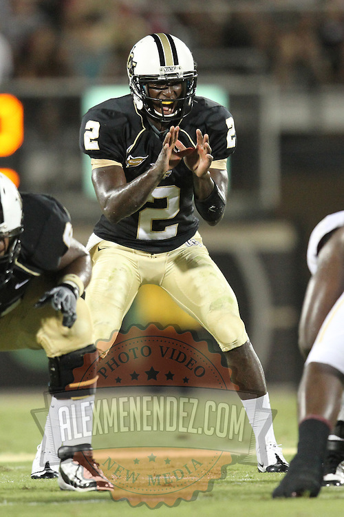 Central Florida quarterback Jeff Godfrey (2) during an NCAA football game between the Boston College Eagles and the UCF Knights at Bright House Networks Stadium on Saturday, September 10, 2011 in Orlando, Florida. (AP Photo/Alex Menendez)