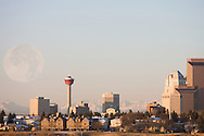 © 2007 Randy Vanderveen, all rights reserved.Calgary, Alberta.Calgary composite photo of full moon over Calgary's downtown looking southwest toward the city from east of the Deerfoot.