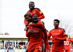 Luton Town's Pelly-Ruddock Mpanzu (bottom) celebrates scoring his side's first goal with team mates during the Sky Bet League One match at Kenilworth Road, Luton.