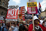 Tens of thousands of protesters gather to march and demonstrate at the Together Against Trump national demonstration on 13th July 2018 in London, United Kingdom. Organisations The Stop Trump Coalition and Stand Up to Trump have come together for a one-off national demonstration to protest against President Trump's policies and politics during his official UK visit.