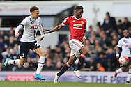 Timothy Fosu-Mensah of Manchester United and Dele Alli of Tottenham Hotspur chasing the ball. Barclays Premier league match, Tottenham Hotspur v Manchester Utd at White Hart Lane in London on Sunday 10th April 2016.<br /> pic by John Patrick Fletcher, Andrew Orchard sports photography.