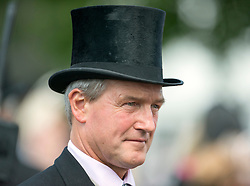 © Licensed to London News Pictures. 07/06/2014. Epsom, UK. Environment Secretary Owen Paterson in a top hat.  Derby Day today 7th June 2014 at Epsom 2014 Investic Derby Festival in Surrey. Traditionally, elegant, fashionable racegoers gather for a classic day's racing at Epsom Racecourse, Surrey. Photo credit : Stephen Simpson/LNP