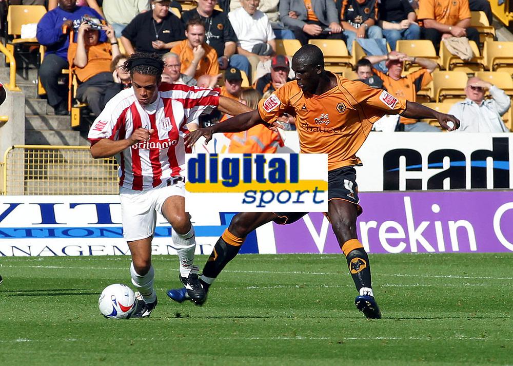 Photo: Dave Linney.<br />Wolverhampton Wanderers v Stoke City. Coca Cola Championship. 23/09/2006.Wolve's Seyi Olofinjana(R) tackles   Darel Russell