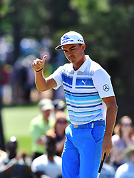Rickie Fowler gives a thumbs up to Thomas Pieters following a chip to the green on the 2nd hole during the third round of the Masters Tournament at Augusta National Golf Club in Augusta, Ga., on Saturday, April 8, 2017. (Photo by Brant Sanderlin/Atlanta Journal-Constitution/TNS) *** Please Use Credit from Credit Field ***