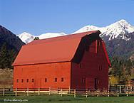 Red barn with Wallowa Mountains near Joseph, Oregon, USA