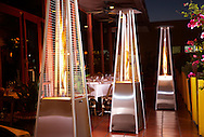 Three beautiful stainless steel propane heaters that give of a radient light.
