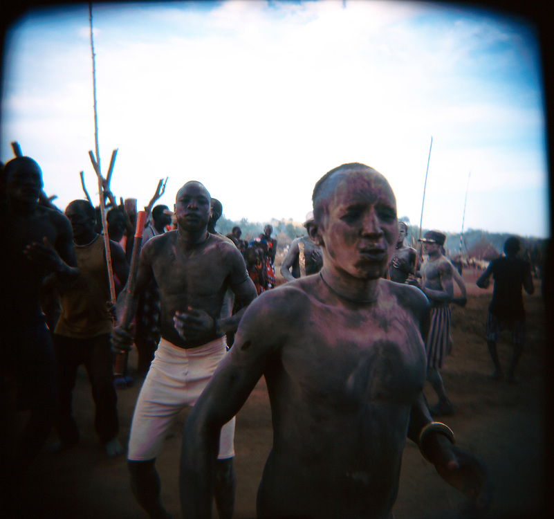 Mundari herdsmen dance during a ceremony at a cattle camp in Central Equatoria Province. The tribe suffered from inter-tribal conflicts and cattle russling in the northern part of the province, so they moved further south looking for safer grazing land. The area where they settled is contaminated with unexploded ordinance and landmines. Continuing tribal violence is forcing more and more people to be displaced and to arrive in the camp..Kuruki, South Sudan. 12/10/2009..Photo © J.B. Russell