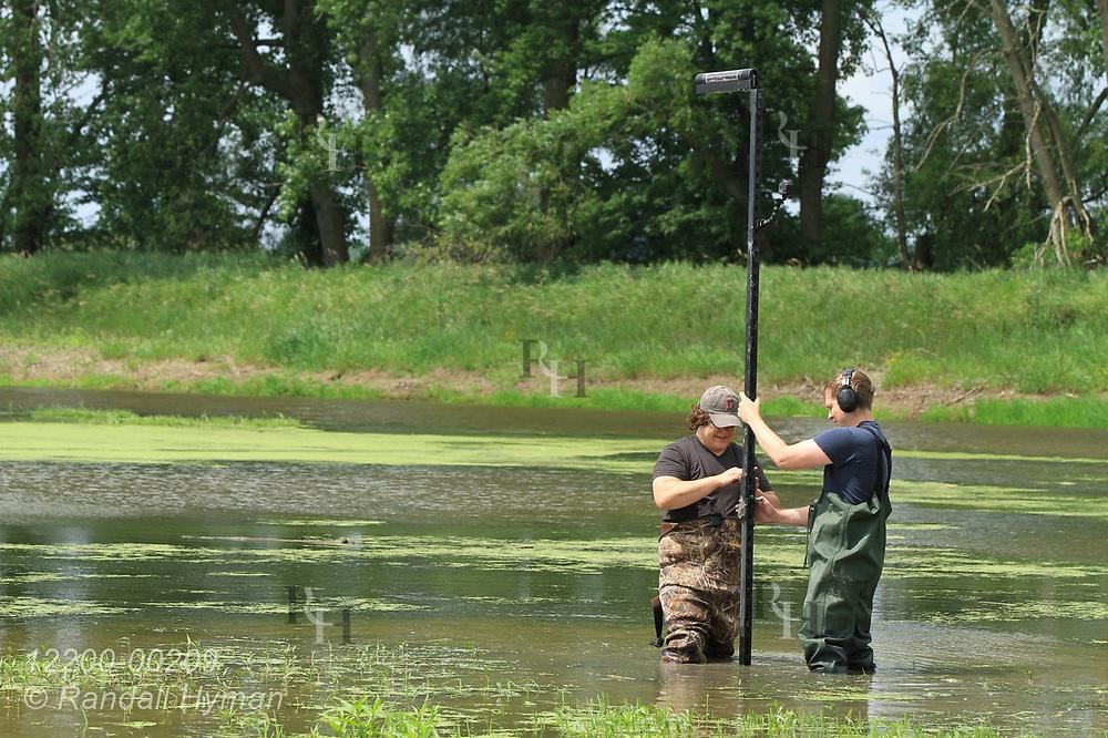 Hyfi field techs Nik Krantz and Matt Craddock (l,r) install water-level sensor in wetland at Shiawassee National Wildlife Refuge; Saginaw, Michigan.