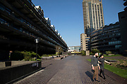 Brutalist architecture exterior from the Highwalk in the Barbican Estate in the City of London, England, United Kingdom. The Barbican Centre is a performing arts centre within the Barbican Estate and is owned, funded, and managed by the City of London Corporation.
